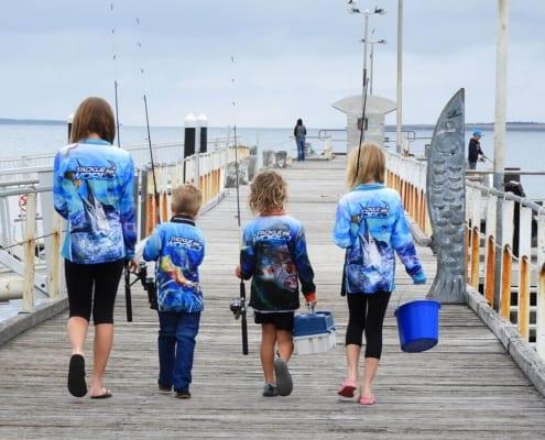 kids walking down a jetty