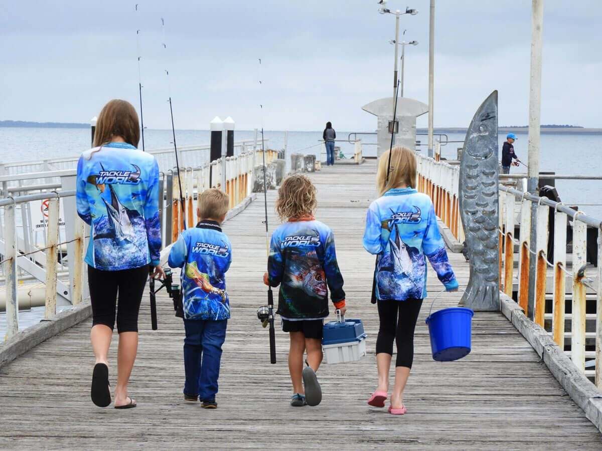 kids walking down a jetty