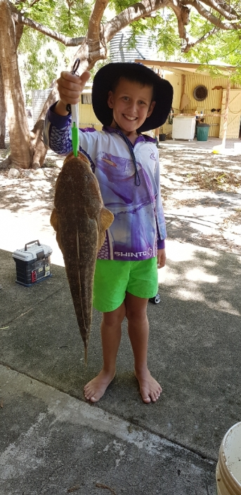 Tackle World's Local Hero Ryley Siandri. Ryley is holding the rewards for his hard work, a nice big flathead.
