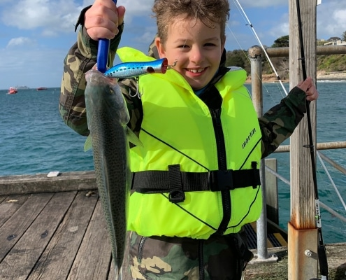 Tackle World's Local Hero Dexter with a great salmon caught on a popper