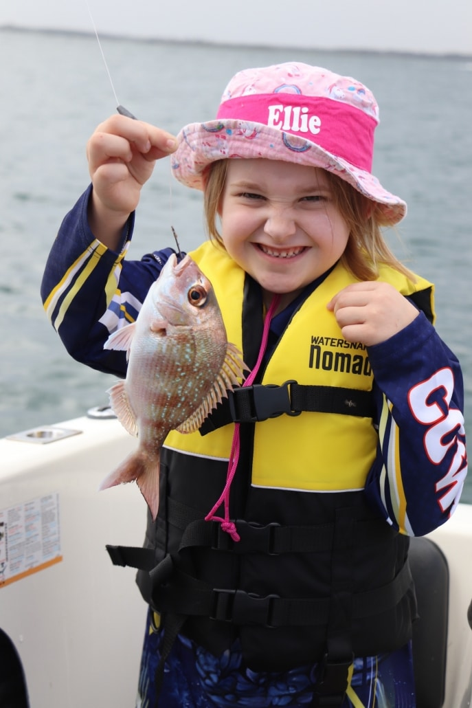 Tackle World local hero Ellie. Very first fish. It even had pretty blue eye shadow and pink spots.