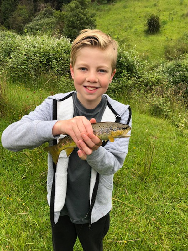 Local Hero Ethan with a brown trout