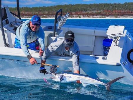 Brent Hancock and Chozza Chorley from Hervey Bay Fly & Sportfishing handle a juvenile black marlin