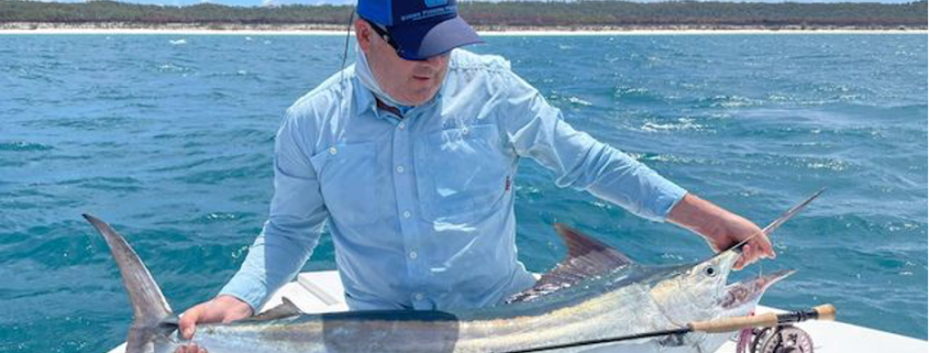 Brent Hancock from Tackle World Port Stephens with a juvenile black marlin caught on the fly.